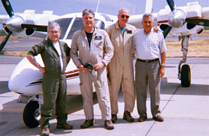 At Comolapa Air Force Base, from the left, NDCF Operations Officer Tom McNaughton; Maj F. Andy Messing (US Special Forces, Ret.) and NDCF Executive Director; Joe Williams, NDCF Senior Pilot; and, Col Hector Lobo (El Salvadoran Air Force, Ret.) with the AC-500 Aero Commander that delivered medicine in Sonsonate, El Salvador