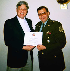 In 2001, NDCF conducted a fact-finding mission in Colombia to examine the counterdrug effort. NDCF Director F. Andy Messing Jr. (US Special Forces, Ret.) delivered an award from U.S. Rep. Dan Burton to Colombian Gen. Gallago for his successful arrest of counterfeiters who were producing millions of dollars in U.S. (Photo: NDCF) currency. (right)
