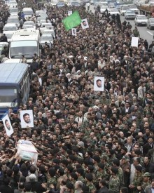 Iranians carry a picture and coffin of Hassan Tehrani Moghaddam, a Revolutionary guards commander, who was killed during a blast in a military base, in Tehran