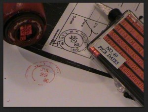"Exhibit F: ""80"" two-digit PICA Post Office date stamp in Barack Obama's Selective Service registration (black stamp) and in the date stamp produced by Sheriff Arpaio's investigators (red stamp)"