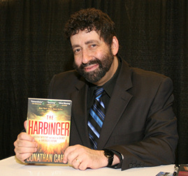 "Rabbi Jonathan Cahn holds his bestselling book, ""The Harbinger"""
