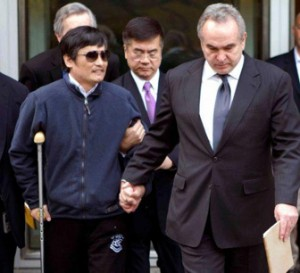 Chen Guangcheng, injured from his escape, is escorted by U.S. Assistant Secretary of State for East Asia and Pacific Affairs Kurt Campbell, right, and U.S. Ambassador to China Gary Locke leaving the U.S. Embassy for a hospital in Beijing on Wednesday, May 2, 2012. (Photo by U.S. Embassy Beijing Press Office)