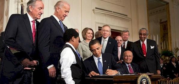 signing_obamacare