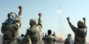 Members of the Iranian Revolutionary Guard celebrate long-range missile launch