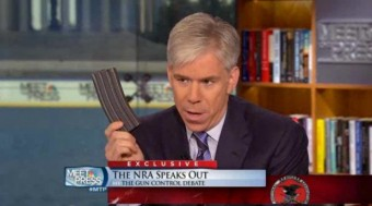 "David Gregory holds a gun clip on ""Meet the Press"" in December 2012"