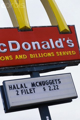 ca. 2001, Dearborn, Michigan, USA --- One of two McDonald's in America, both located in Dearborn, which serve halal meats. Halal meats come from animals slaughtered in the way prescribed by Shari'a, or Islamic law. --- Image by © Ed Kashi/CORBIS
