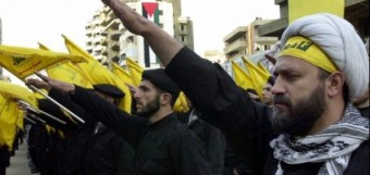 Hezbollah fighters give the Nazi salute