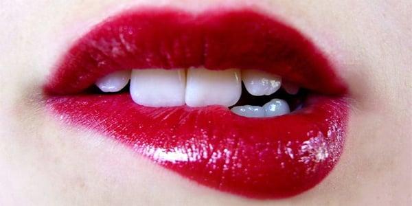 Lesbian kissing on the lip