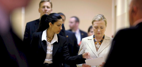 Huma Abedin (left) and Hillary Clinton (right)