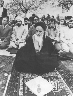 Hassan Rohani during prayers, behind the founder of the Islamic Revolution, Grand Ayatollah Ruhollah Khomeini