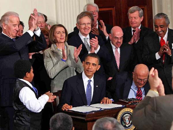 Obama signs the Affordable Care Act, his signature legislation, into law in 2010