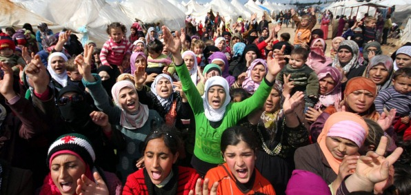Syrian refugees at a protest rally