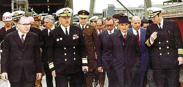 Lt. Gen. Ion Mihai Pacepa, behind the right shoulder of Romanian dictator Nicolae Ceausescu
