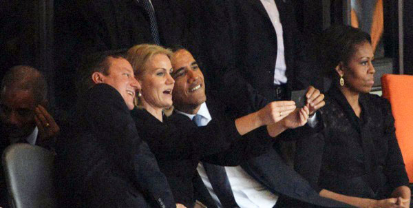 Barack Obama takes a selfie photograph with other world leaders at the memorial service for South Africa's Nelson Mandela.