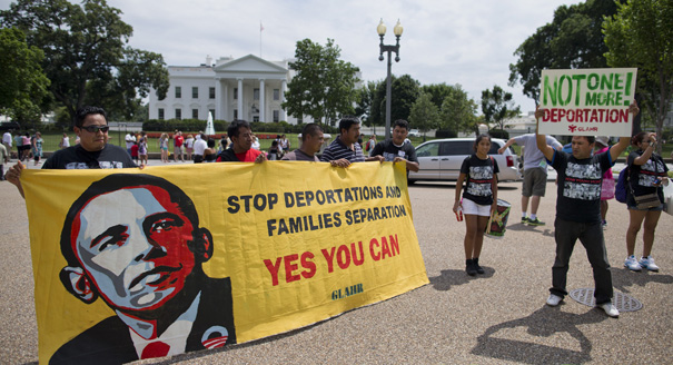 Demonstrators rally in front of the White House in Washington, Wednesday, July 24, 2013, calling for immigration reform. The demonstrators urged President Barack Obama to use executive authority to expand the policy that allowed hundreds of thousands of illegal immigrants who came to the United States as children to remain. (AP Photo/Evan Vucci)