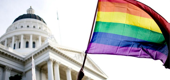 The rainbow flag flies over the state Capitol in Sacramento, California.