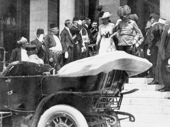 Archduke Franz Ferdinand of Austria and his wife descend the steps of the City Hall, Sarajevo to their motor car, a few moments before their assassination, June 28th, 1914 (Imperial War Museums)