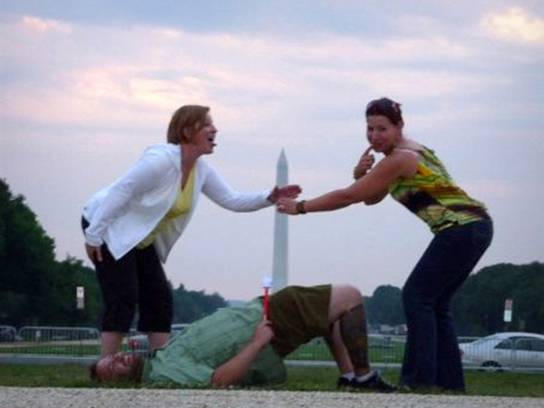 Penny Mueller, left, and fellow teacher Marti Ingram pose in a simulated sex act involving the Washington Monument in July 2009. (Facebook)