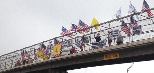Protesters on the overpass above I-240 in Oklahoma City, Oklahoma, on Friday, July 18.