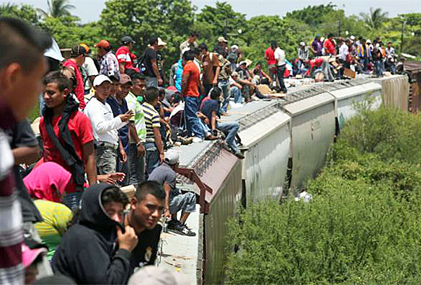 "Children ride atop the ""Beast"" for a train ride to the border and an eventual entry into the U.S."