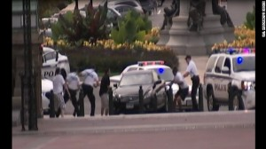 Police with guns drawn surround Miriam Carey on Oct. 3, 2013