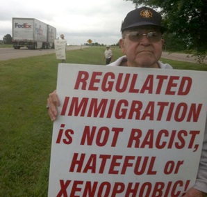 Protester makes his statement in Grand Island, Nebraska, Friday, July 18.