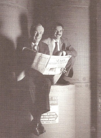 Jim Smith and I sit atop the newsprint rolls at the Sacramento Union, circa 1990