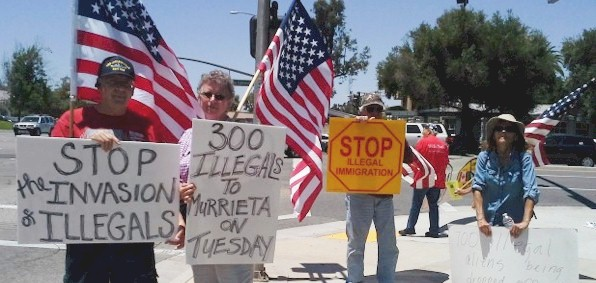 Protesters like these in Murrieta, California, in July are planning to greet President Obama Friday morning in Las Vegas.