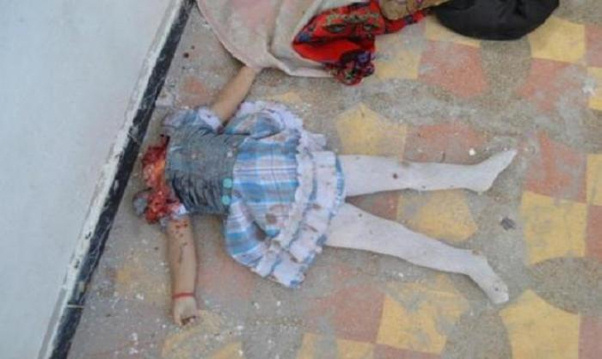 Image of child's decapitated body (image courtesy Catholic.org)