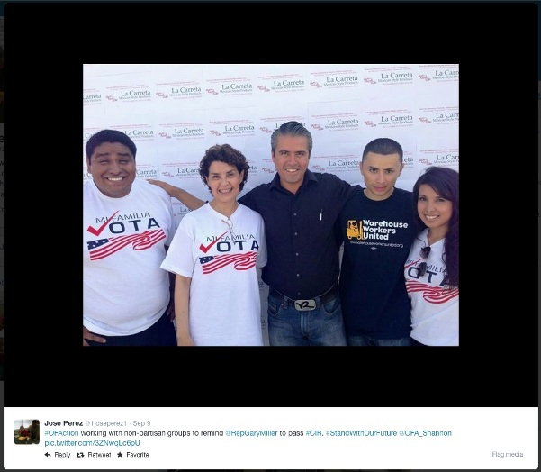 Jose Perez with supporters of Mi Familia Vota