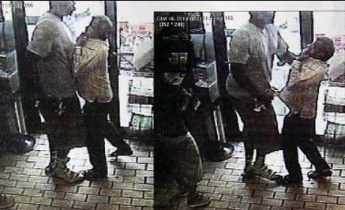 Surveillance video shows robbery suspect believed to be Michael Brown strong-arming clerk.