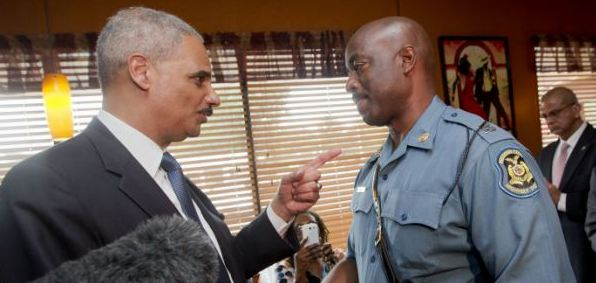 Attorney General Eric Holder talks Wednesday with Capt. Ron Johnson of the Missouri State Highway Patrol, who has been put in charge of security in Ferguson, Missouri.