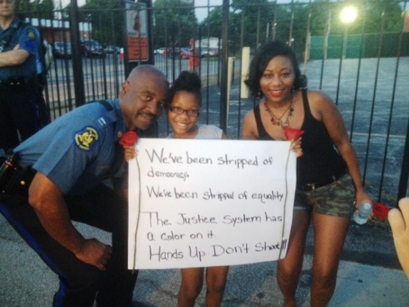 Missouri Highway Patrol Capt. Ron Johnson, left, with protesters in Ferguson, Missouri, Thursday night