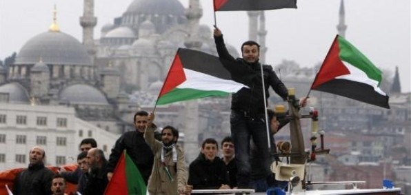 Pro-Palestinian activists wave Palestinian flags on the cruise liner Mavi Marmara as it is welcomed in Istanbul Dec. 26, 2010, after trying to break the blockade on the Gaza Strip.