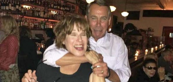 House Speaker John Boehner holds comedienne Joy Behar in a headlock in the Hamptons