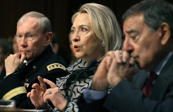 Then-Secretary of State Hillary Clinton speaking Senate Foreign Relations Committee hearing May 23, 2012, flanked by Chairman of the Joint Chiefs of Staff Martin Dempsey, left, and then-Defense Secretary Leon Panetta.