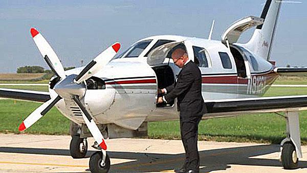 Senate candidate Dr. Doug Butzier with his plane in Mason City, Iowa.