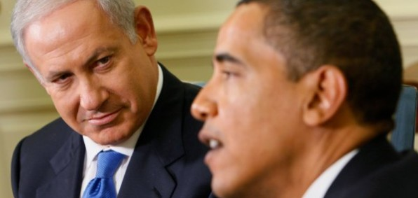 Israeli Prime Minister Benjamin Netanyahu looks on while U.S. President Barack Obama speaks