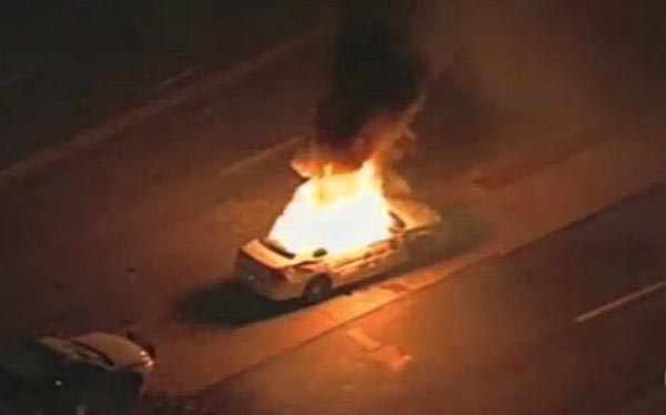 Car burns in Ferguson as President Obama speaks