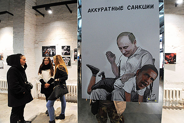 """Vladimir Putin spanks Barack Obama in """"Targeted Sanctions,"""" part of a new art gallery in Moscow."""