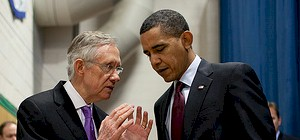 Then-Senate Majority Leader Harry Reid with President Obama in 2014.