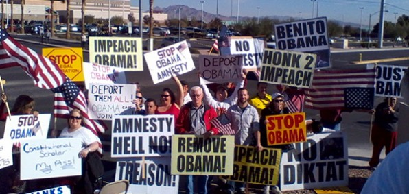 Some of the protesters who greeted President Obama's motorcade as it pulled into Del Sol High School in Las Vegas, Nevada, Friday, Nov. 21.