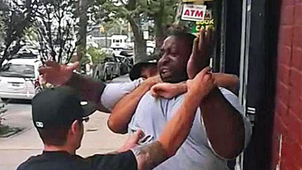 Eric Garner held by police