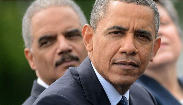 Former Attorney General Eric Holder and former President Obama