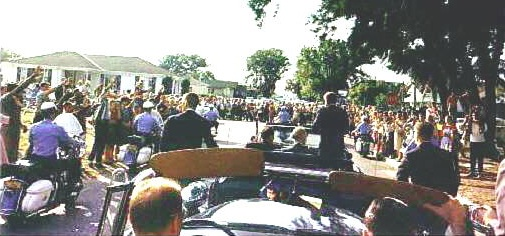JFK motorcade in Tampa, Florida, Nov. 18, 1963, with Secret Service agents Chuck Zboril, (left, and Don Lawton, right, riding on or near the back of the presidential limousine.
