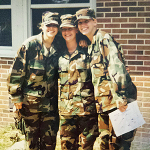 Chelsea Schilling (right) with fellow Army soldiers after basic training