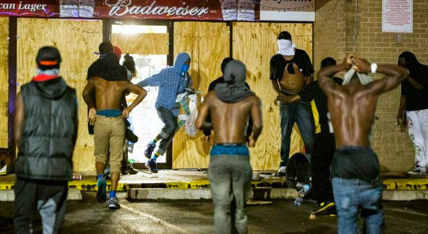 Protesters tear up businesses in Ferguson, Missouri.