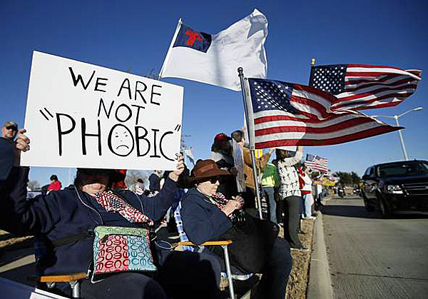 Hundreds of protesters show up in Garland, Texas, for a secret Muslim conference Saturday, Jan. 18, 2015.