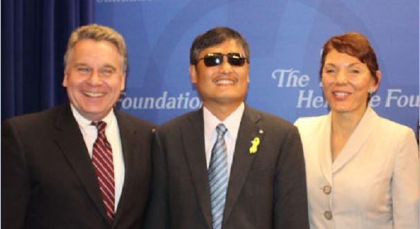 Congressman Chris Smith, Chinese activist Chen Guangcheng, and Women's Rights Without Frontiers President Reggie Littlejohn spoke out against coercive family planning in China at The Heritage Foundation in October 2014