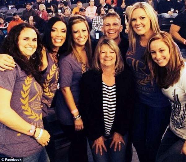 Teri Roberts is pictured with her son and his friends in a Facebook photo taken before her illness.